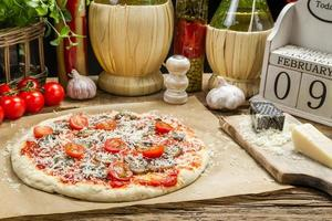 Preparing homemade pizza with fresh ingredients photo