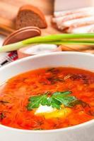 Ukrainian national red borscht with sour cream closeup