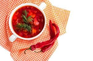 Borsch in white plate isolated on white. Red traditional beetroot soup