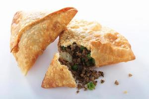meat samosas on white platter