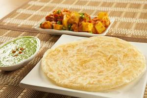 Paratha with green chutney and mixed aloo bhaaji vegetables photo