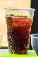 cola with ice in cup photo