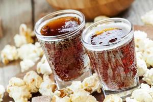 Caramel popcorn and cola in a glass
