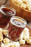 Caramel popcorn and cola in a glass photo