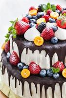 Chocolate cake decorated with fresh fruits