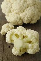 fresh cauliflower on wooden background photo