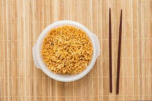 Noodle with chopsticks photo