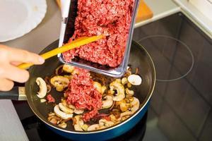 Proces of preparing spaghetti Bolognese photo