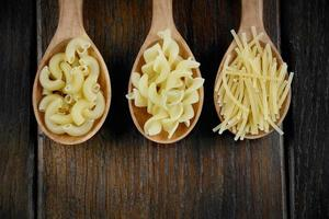 Tree spoons with different kinds of pasta