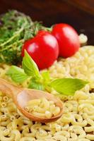 Raw Chifferi pasta with wooden spoon