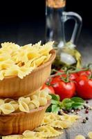 Raw conchiglie and farfalle pasta photo