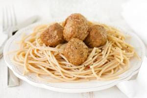 meatballs with spaghetti in white plate