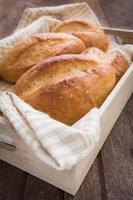 Baguette or bread in wooden tray