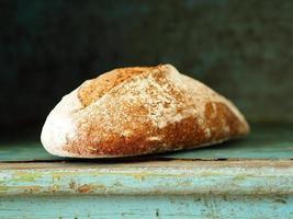 Bread on wooden shelf in bakery