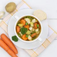 Vegetable soup meal with vegetables carrots in bowl from above