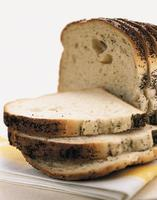 sliced loaf of poppy seed bread photo