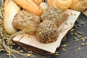 types of bread on a wooden table photo