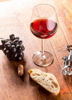 Red wine against wooden background