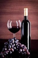 Wine and grape on a background of a canvas