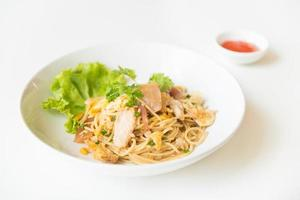 Stir fried Spaghetti with Chicken and egg. and egg. photo