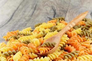 Raw eliche tricolori pasta background photo