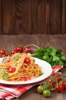Spaghetti pasta with tomatoes and parsley