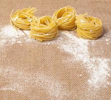 Pasta with flour on sacking