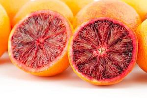 ripe red blood oranges and slices