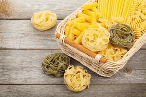 Pasta on wooden table photo