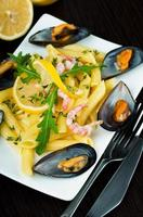 Pasta with mussels, shrimp and lemon photo