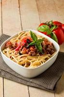 Pasta with italian sausage meat sauce photo