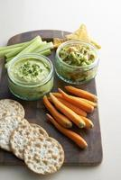 Avocado paste with vegetable and cracker photo