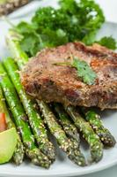Glazed green asparagus with grilled pork chop