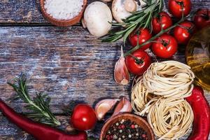 Ingredients for pasta on a wooden background