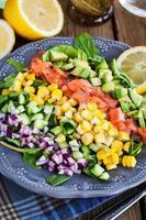 Salmon, avocado, corn, cucumber and onion salad