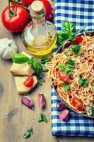 Spaghetti bolognese with cherry tomato and basil.