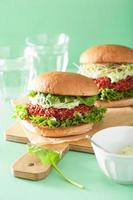 vegan beet and quinoa burger with avocado dressing