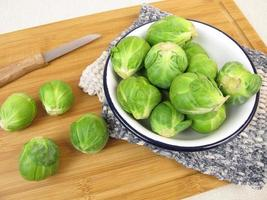 Brussels sprout in bowl on wooden board