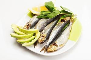 Smoked fishes on plate