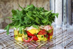 Fresh tomato and avocado with aromatic herbs