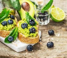 Sandwiches with avocado, blueberries and spinach photo