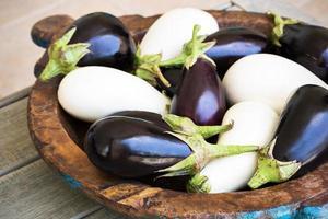 Different color eggplants photo