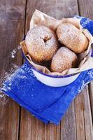 Cinnamon doughnuts in metal rustic bowl on wooden background