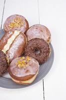 tasty donuts on platter