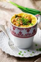 quiche in a mug prepared in microwave photo