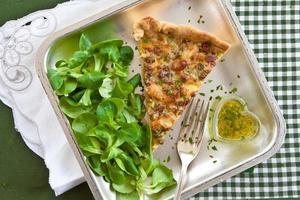 Quiche Lorraine and lamb's lettuce photo