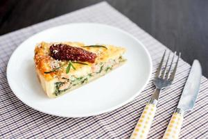 Piece of pie with spinach and fish salmon