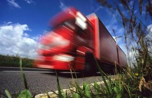worms eye view of lorry travelling on country road uk photo