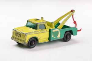 Toy tow truck ready to pull car vintage 1960s