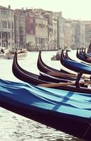 Gondolas at Grand canal in Venice, Italy.